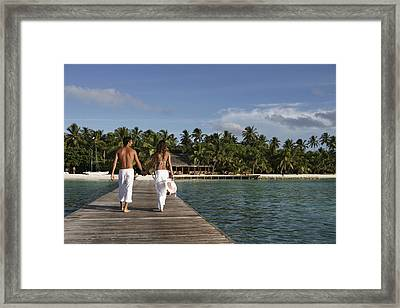 Maldives, Couple Walking On Pier � Framed Print by Tips Images