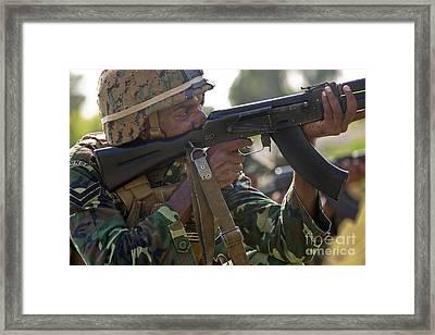 Maldivian Marine Fires An Ak-47 Service Framed Print by Stocktrek Images