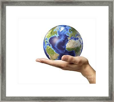 Male Hand Holding Earth Globe Framed Print by Leonello Calvetti