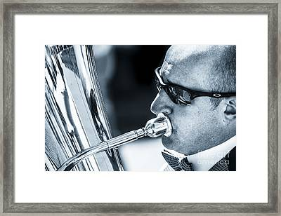 Male In Sunglasses Blowing Mouthpiece Of Tuba Framed Print