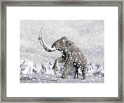 Mammoth Walking Through A Blizzard Framed Print by Elena Duvernay