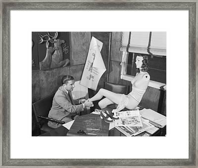 Man Adjusting A Mannequin Framed Print by Arthur S. Siegel