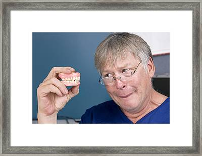 Man And His Dentures Framed Print