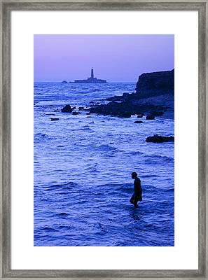 Man And Lighthouse Framed Print