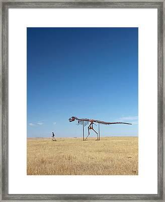 Man And T. Rex Skeletons Framed Print