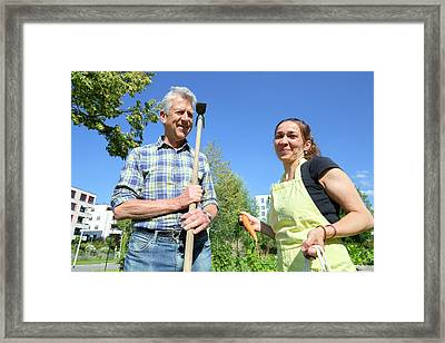 Man And Woman In A Garden Framed Print