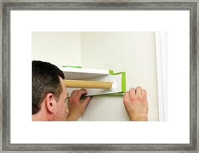 Man Applying Green Painter's Tape Framed Print
