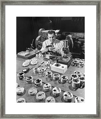 Man Checking Auto Parts Framed Print by Underwood Archives