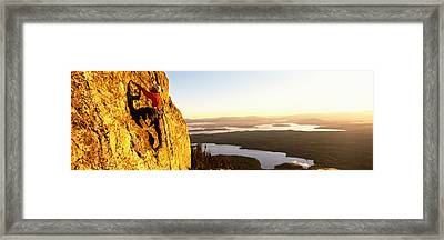 Man Climbing Up A Mountain, Rockchuck Framed Print
