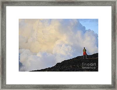 Man Contemplating Clouds Of Steam On Volcano Framed Print by Sami Sarkis
