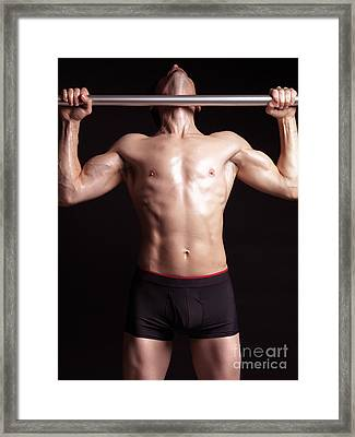 Man Doing Pullups On A Pull Up Bar Framed Print by Oleksiy Maksymenko