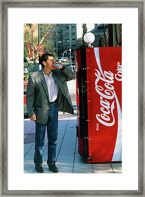 Man Drinking A Can Of Coke Framed Print by Marcelo Brodsky/science Photo Library