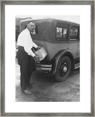 Man Filling Car With Fuel Framed Print by Underwood Archives