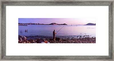 Man Fishing At The Coast, Portoferraio Framed Print