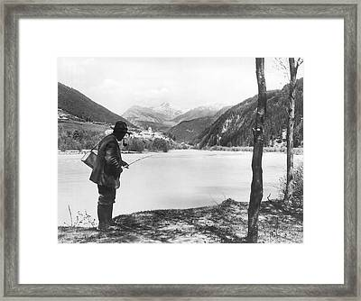 Man Fishing In Switzerland Framed Print by Underwood Archives