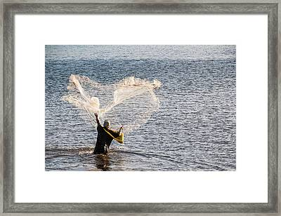 Man Fishing In The Harbor Of Apia Framed Print by Michael Runkel