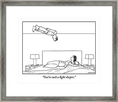 Man Floats Above His Wife In Bed Framed Print