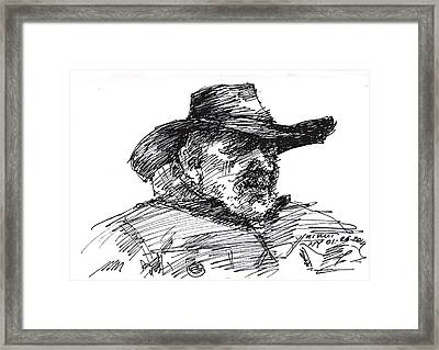 Man In A Cowboy Hat Framed Print