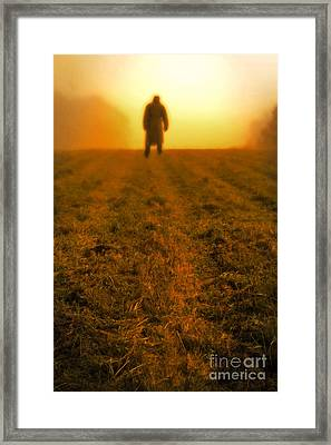 Man In Field At Sunset Framed Print