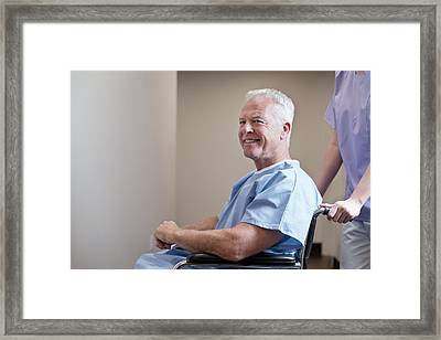 Man In Hospital Gown In Wheelchair Framed Print by Science Photo Library