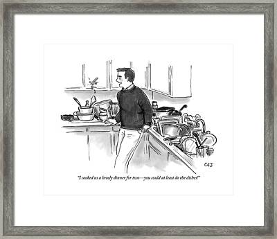 Man In Kitchen Surrounded By Dishes Framed Print