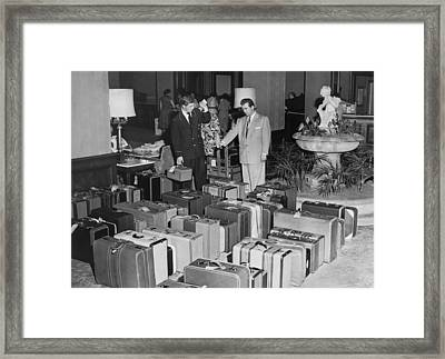Man In Lobby With Suitcases Framed Print