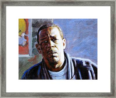 Man In Morning Sunlight Framed Print by John Lautermilch