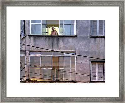 Man In The Window Framed Print by Julie Niemela