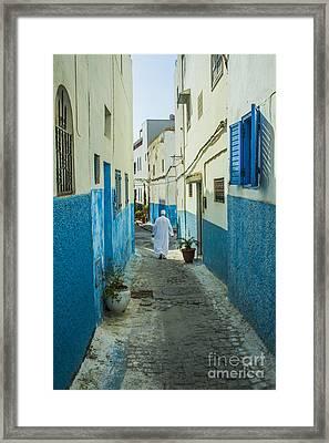 Man In White Djellaba Walking In Medina Of Rabat Framed Print by Patricia Hofmeester