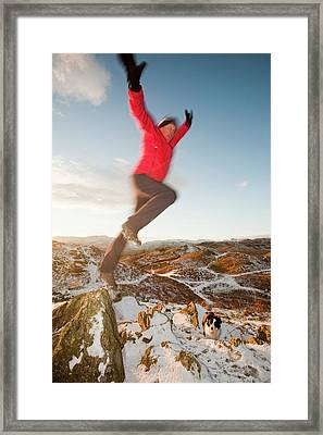 Man Leaping Off Rock Framed Print by Ashley Cooper