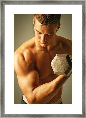 Man Lifting Weights Framed Print by Don Hammond