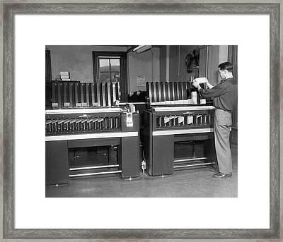 Man Loading Punch Cards Framed Print by Underwood Archives