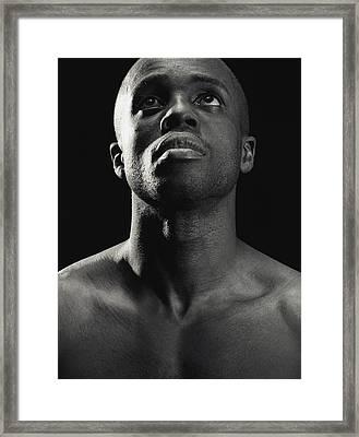 Man Looking Up Framed Print by Darren Greenwood