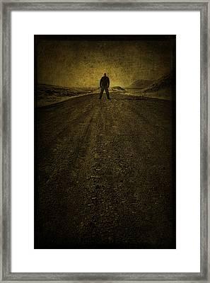 Man On A Mission Framed Print by Evelina Kremsdorf