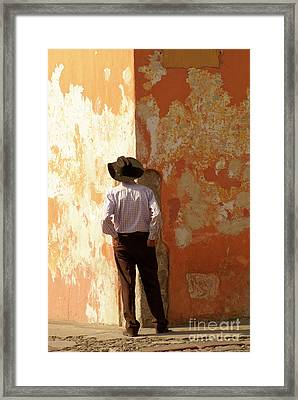 Framed Print featuring the photograph Man On The Corner Antigua Guatemala by John  Mitchell