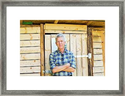 Man Outside Garden Shed Framed Print by Gombert, Sigrid
