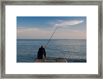 Man Pier Fishing, Lighthouse Beach Framed Print by Panoramic Images