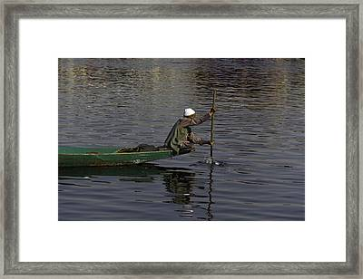Man Plying A Wooden Boat On The Dal Lake Framed Print