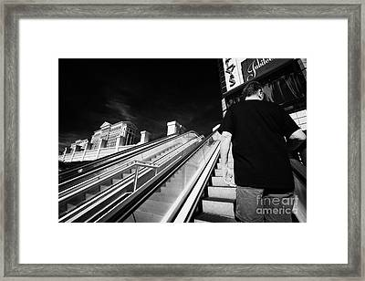 man riding on escalators on Las Vegas boulevard Nevada USA Framed Print