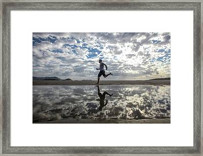 Man Running On Beach Framed Print by Paul Mansfield Photography
