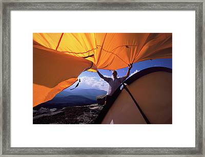 Man Sets Up Tent Up On The Summit Framed Print