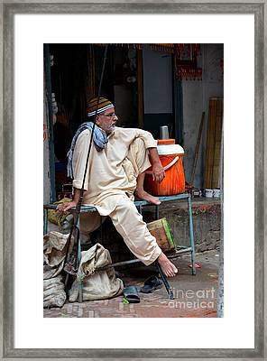 Man Sits And Relaxes In Lahore Walled City Pakistan Framed Print