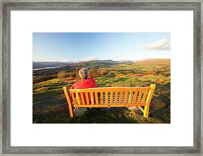 Man Sitting On A Memorial Seat Framed Print by Ashley Cooper