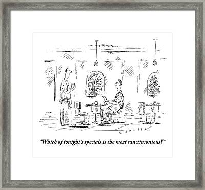 Man Speaks To A Waiter At A Restaurant Framed Print