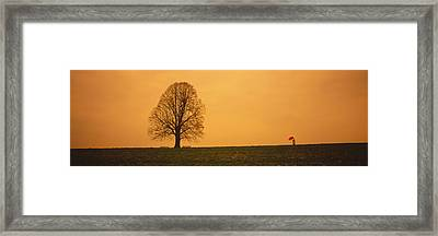 Man Standing With An Umbrella Framed Print by Panoramic Images