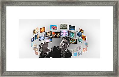 Man Surrounded By Imagery Framed Print by Panoramic Images