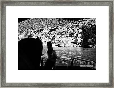 man taking photos with smartphone during boat ride along the colorado river in the grand canyon Ariz Framed Print