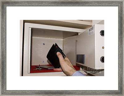 Man Taking Wallet From Hotel In-room Framed Print by Mark Williamson