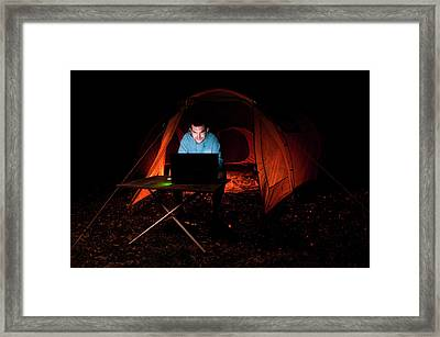 Man Using Laptop Outside A Tent Framed Print by Matthew Oldfield