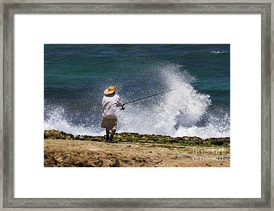 Man Versus The Sea Framed Print by Mike  Dawson